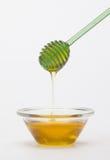 Full honey pot and honey stick Royalty Free Stock Photo