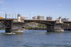 Morrison Bridge on a Sunny Summer Day on the Willamette River with speed boat in Portland Oregon stock image