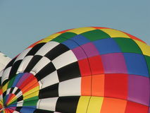 Full of hot air. Inflating hot air balloon Stock Images