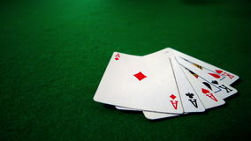 Full house hand falling on casino table Stock Photos