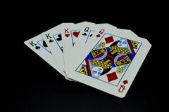 Full house kings over queens cards in poker game against black background stock photos