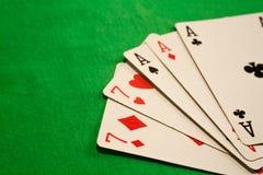 Full house poker cards combination on green background casino luck fortune. Royal flush poker cards combination  casino luck fortune Royalty Free Stock Photo
