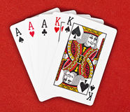 Full House Poker Hand - on Royal Red Background Stock Images