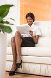 Full image of young black girl with laptop computer. Royalty Free Stock Photo