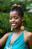Full of Joy. African American woman smiles in the park stock photos