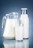 Full Jug, Bottle of fresh milk and glass isolated Stock Images