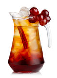 Full jug of fresh nonalcoholic cocktail with grapes and cinnamon Stock Image