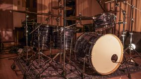 Drum set on Stage. Full kit drum set on stage with lights casting its shadows stock photos