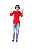 Full längdkvinna i en vinnaregest Royaltyfri Fotografi