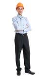 Full längdstående av en lycklig affärsman i hjälm Royaltyfri Bild