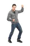 Full längdstående av en male göra en gest lycka arkivfoto