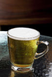Full lager beer in glass mug Stock Photo