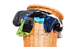 Full laundry basket V1. A laundry basket fully with laundry on white background Stock Photos