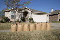 Full lawn bags in front of house Stock Images