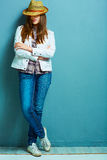 Full leg fashion portrait of young model in american country st Royalty Free Stock Photos