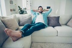 Full legs body size portrait of good-looking brunet hair man sit stock photos