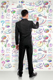Full lenght businessman drawing modern business concept on white Royalty Free Stock Photos