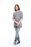 Full lenght of handsome young man with long hair Stock Photo