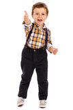 Full lenght portrait of an adorable little boy showing thumbs up Royalty Free Stock Images