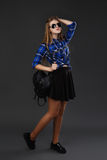 Full-lenght portrait of a girl in a plaid shirt and black skirt Royalty Free Stock Photography