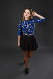 Full-lenght portrait of a girl in a plaid shirt and black skirt Stock Images