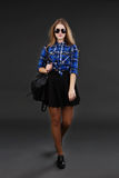 Full-lenght portrait of a girl in a plaid shirt and black skirt Royalty Free Stock Image