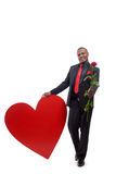 Full lenght portrait leaning on big heart. royalty free stock photos