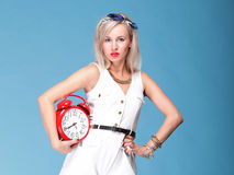 Full lenght Portrait pretty young woman red clock Stock Photography