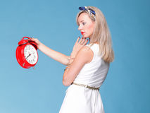Full lenght Portrait pretty young woman red clock Stock Image
