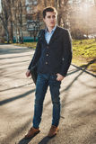 Full-lenght portrait of young man wearing a casual black jacket and jeans Royalty Free Stock Image