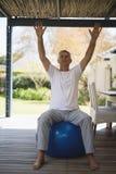 Full lenght of senior man exercising at porch Stock Images