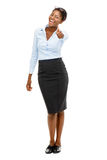 Full length African American businesswoman thumbs up on white ba Stock Photo