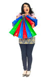 Full length of amazed woman with bags Royalty Free Stock Photos