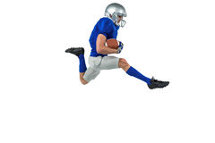 Full length of American football player running with ball Royalty Free Stock Photo