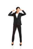 Full length angry businesswoman making fists Royalty Free Stock Photo