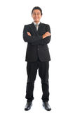 Full length Asian businessman arms folded Royalty Free Stock Photo
