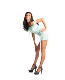 Full length of attractive young brunette female in mini dress posing on white background Royalty Free Stock Images