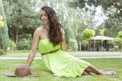 Full length of attractive young woman in sundress at park Royalty Free Stock Photo