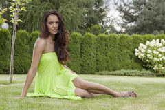 Full length of attractive young woman in sundress relaxing at park Royalty Free Stock Photo
