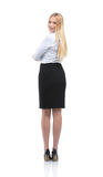 Full-length back side of business woman looking on camera, isola. Business woman stand profile with white wall background Royalty Free Stock Images