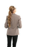 Full-length back side of businesswoman, isolated on white. Stock Photography