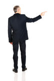 Full length back view businessman pointing right Stock Photography