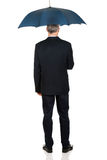 Full length back view businessman with umbrella Stock Images