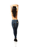 Full length back view shirtless woman with arms up Royalty Free Stock Photos