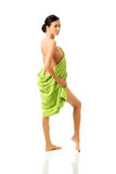 Full length back view woman wrapped in towel Royalty Free Stock Image