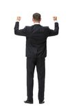 Full-length backview of businessman with fists up Royalty Free Stock Photos