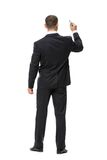 Full-length backview of businessman with marker Royalty Free Stock Photography