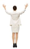 Full-length backview of businesswoman with hands up Stock Photos
