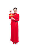 Full length of a beautiful Asian woman on traditional festival c. Ostume Ao Dai. Tet holiday. Lunar New Year. Text mean Lucky and Happiness royalty free stock image