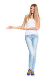 Full length of beautiful blond woman pointing at copy space isolated Royalty Free Stock Photography